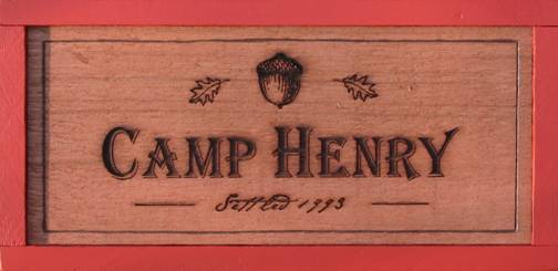 cedar wooden sign featuring an acorn, camp sign