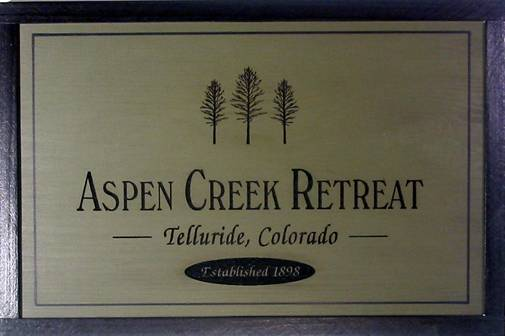 pine wooden sign featuring aspen trees, aspen tree camp sign